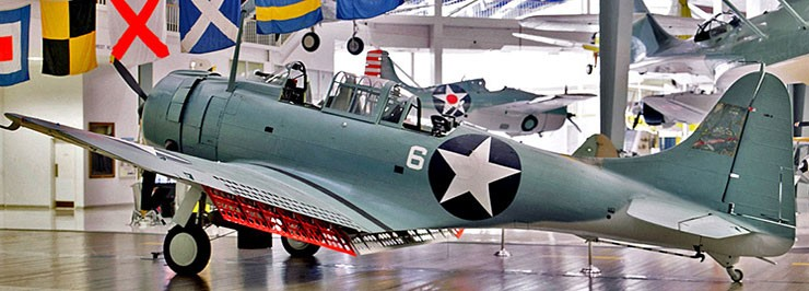 Color photo of SBD-2 Dauntless (Bureau Number 2106) on display at the National Naval Aviation Museum in Pensacola, Florida.