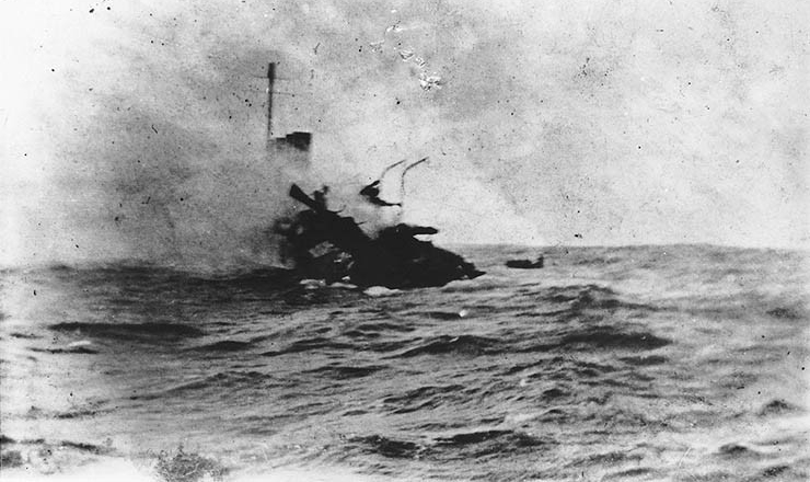 USS Jacob Jones  (Destroyer # 61) Sinking off the Scilly Islands, England, on 6 December 1917, after she was torpedoed by the German submarine U-53. Photographed by Seaman William G. Ellis. Smithsonian Institution Photograph.