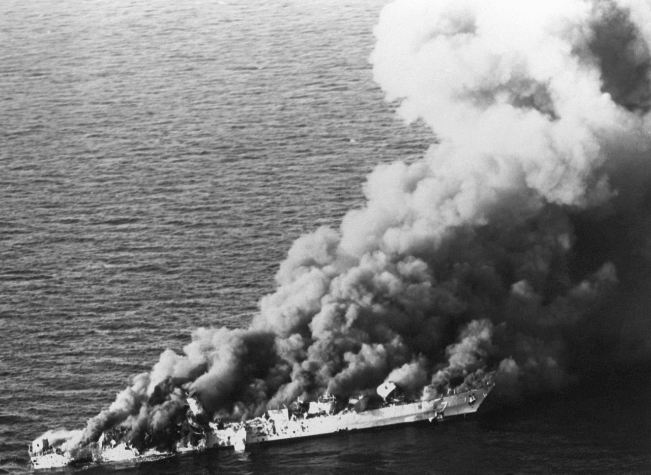 Jets flying from aircraft carrier Enterprise (CVN-65) sink Iranian frigate Sahand (74) in retaliation for the mining of Samuel B. Roberts, four days later during Operation Praying Mantis, 18 April 1988. (U.S. Navy Photograph 081212-N-1522S-005, Navy NewsStand)