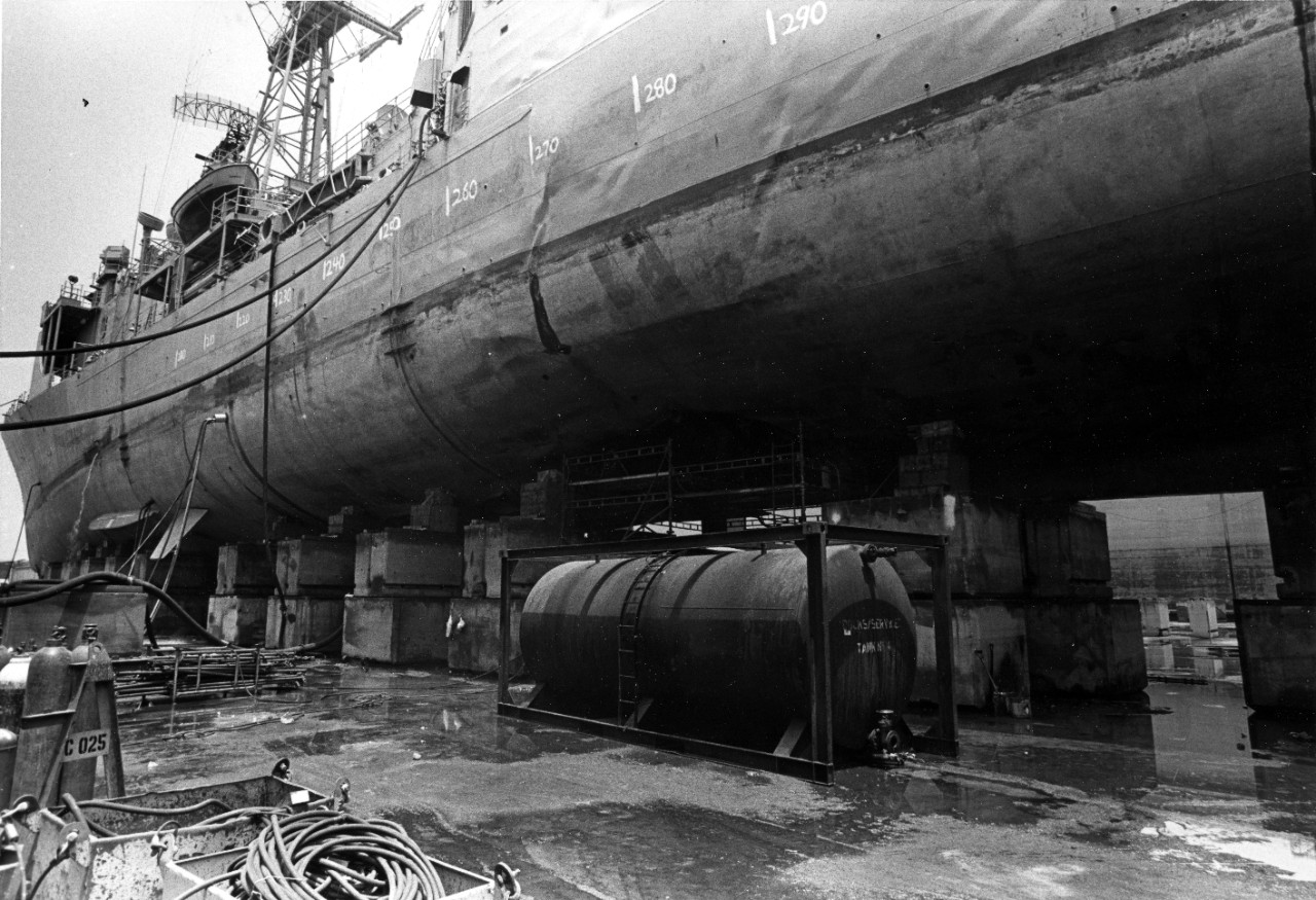 A view of damage to the hull of USS Samuel B. Roberts (FFG-58) while in dry dock in Bahrain.