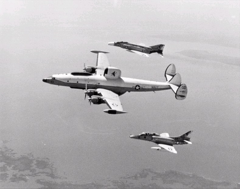 A U.S. Navy Lockheed EC-121K Warning Star (BuNo 141292) from electronic warfare squadron VAQ-33 Firebirds in formation with a Douglas EA-4F Skyhawk and a McDonnell F-4B Phantom II off the coast of Virginia (USA) in April 1973.