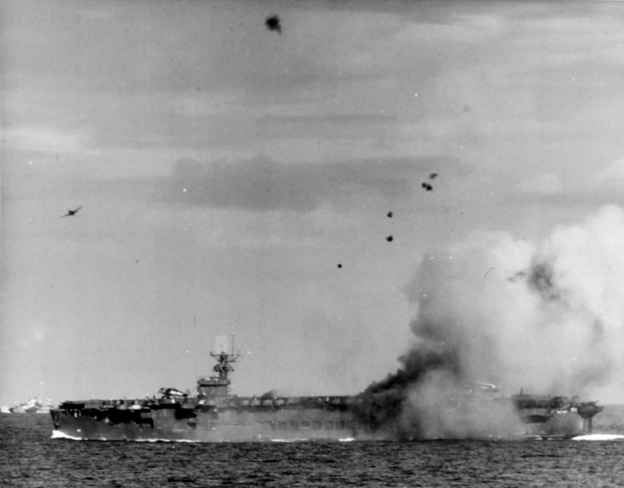 F6F completing pullout after chasing Zeke which crashed into USS Suwannee (CVE-27), 25 October 1944. Taken by USS Petrof Bay (CVE-80) Air Department.