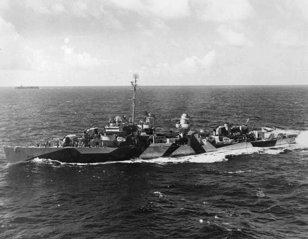 USS Morrison (DD-560) underway, in a photo taken from USS Gambier Bay (CVE-73). Another aircraft carrier can be seen in the distance.