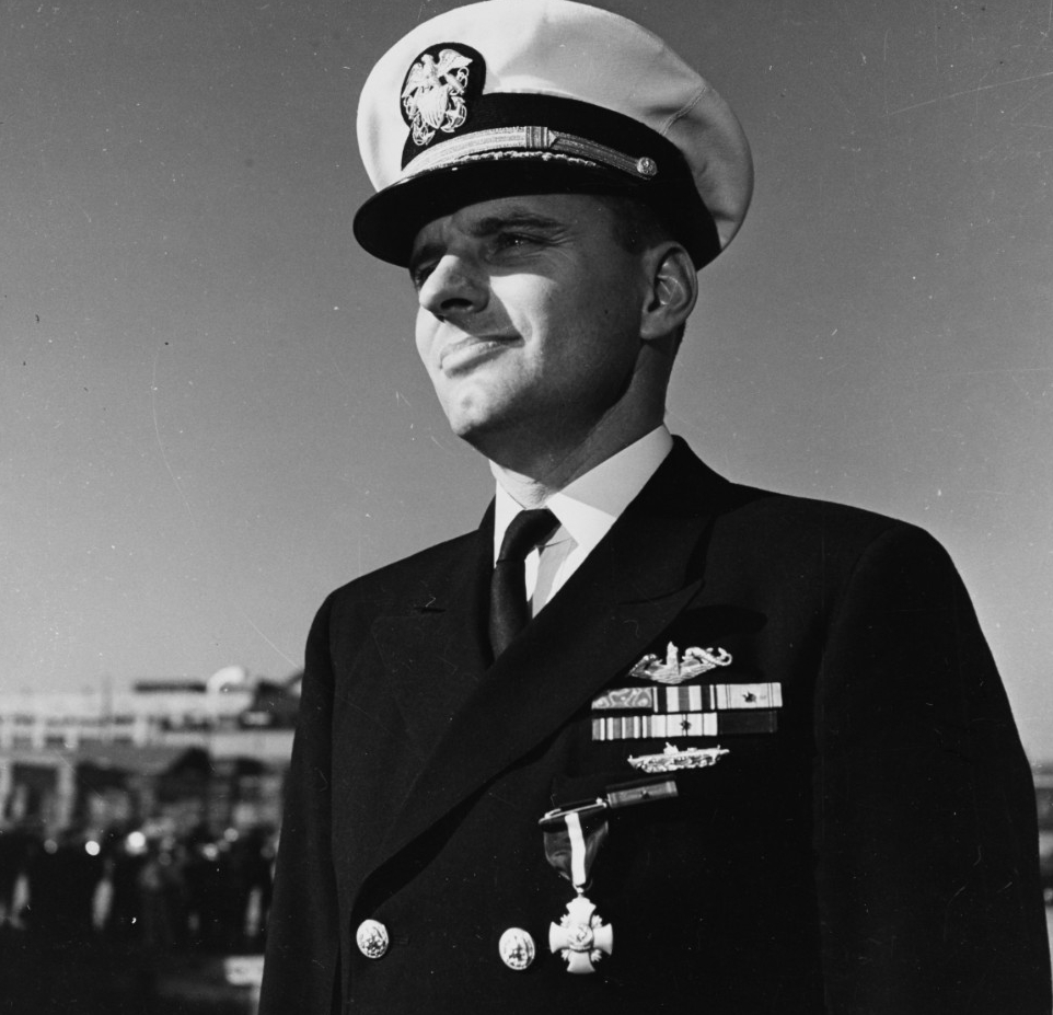 Commanding Officer of USS Tirante (SS-420) At the Washington Navy Yard, D.C., just after receiving the Navy Cross from Secretary of the Navy James Forrestal on 19 October 1945. He was awarded the medal for extraordinary ship-hunting efforts during Tirante's war patrols earlier in the year. Street also received the Medal of Honor for conspicuous gallantry and intrepidity in action against Japanese forces on 14 April 1945. The ribbon for the Medal of Honor is in the top row of his ribbons, immediately below his submarine service dolphins. Official U.S. Navy Photograph, now in the collections of the National Archives.