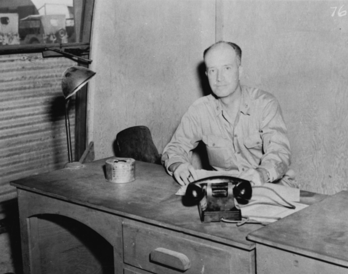 Black-and-white photograph of Captain William S. Parsons seated in front of a small desk.