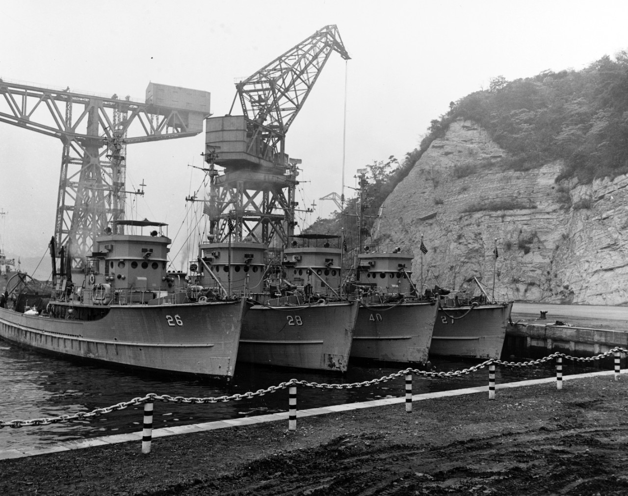 Four U.S. Navy minesweepers (AMS) tied up at Yokosuka, Japan