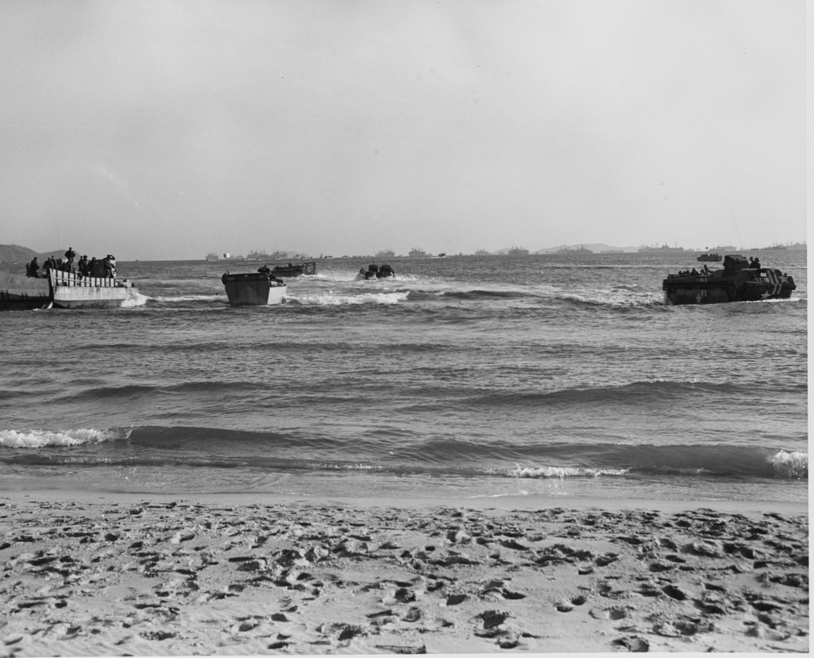 LVTs, LCVPs, and an LCM beaching on the Kalmo Pando, at Wonsan, North Korea.