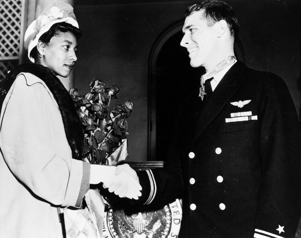 Hudner shaking hands with Ensign Brown's widow
