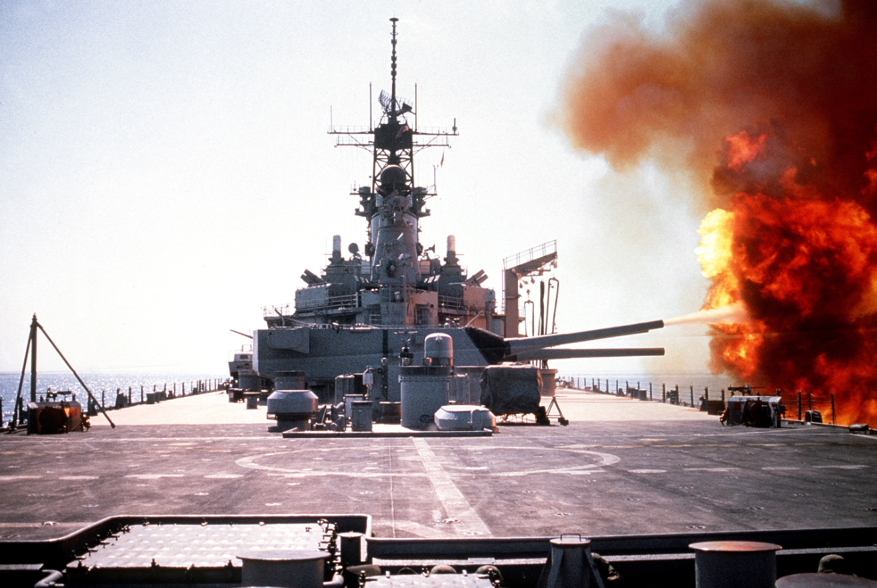 The battleship USS Wisconsin (BB-64) fires a round from one of the Mark 7 16-inch/50-caliber guns in its No. 3 turret during Operation Desert Storm. (National Archives Identifier: 6480274)