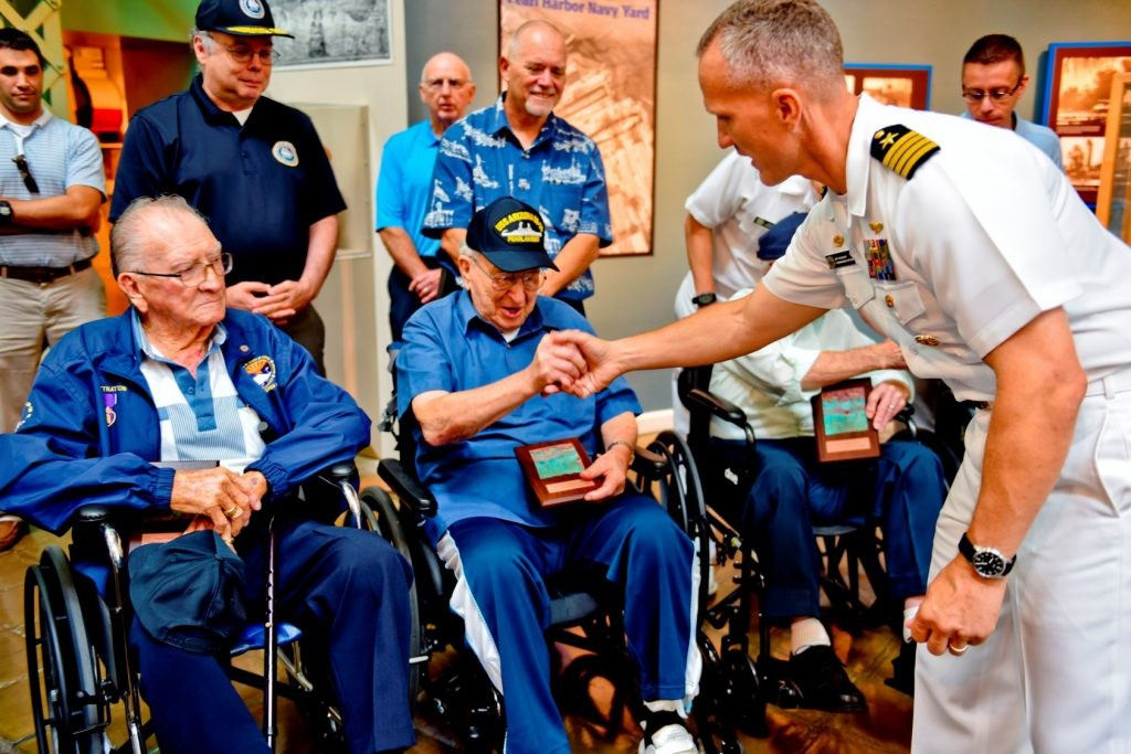 Adm. Samuel Cox, director of Naval History and Heritage Command, and Capt. Jeff Draeger, commanding officer of Naval Support Activity Washington, welcome three of the five remaining USS Arizona Survivors from Pearl Harbor to the National Museum of the United States Navy