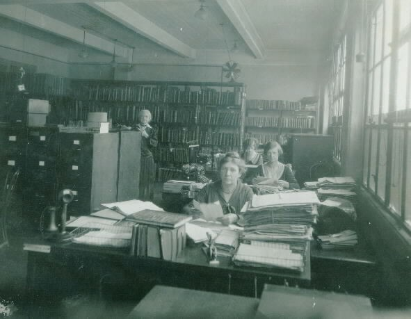 Old Records, Office of Naval Records & Library. Miss N.D. Barney in charge, Miss E. Cravan, Mrs. A. Lawrence and Mrs. Alice Thomas, 1930. Photo by Childs, C&R. Naval Historical Center, Photographic Section, #NH000423.