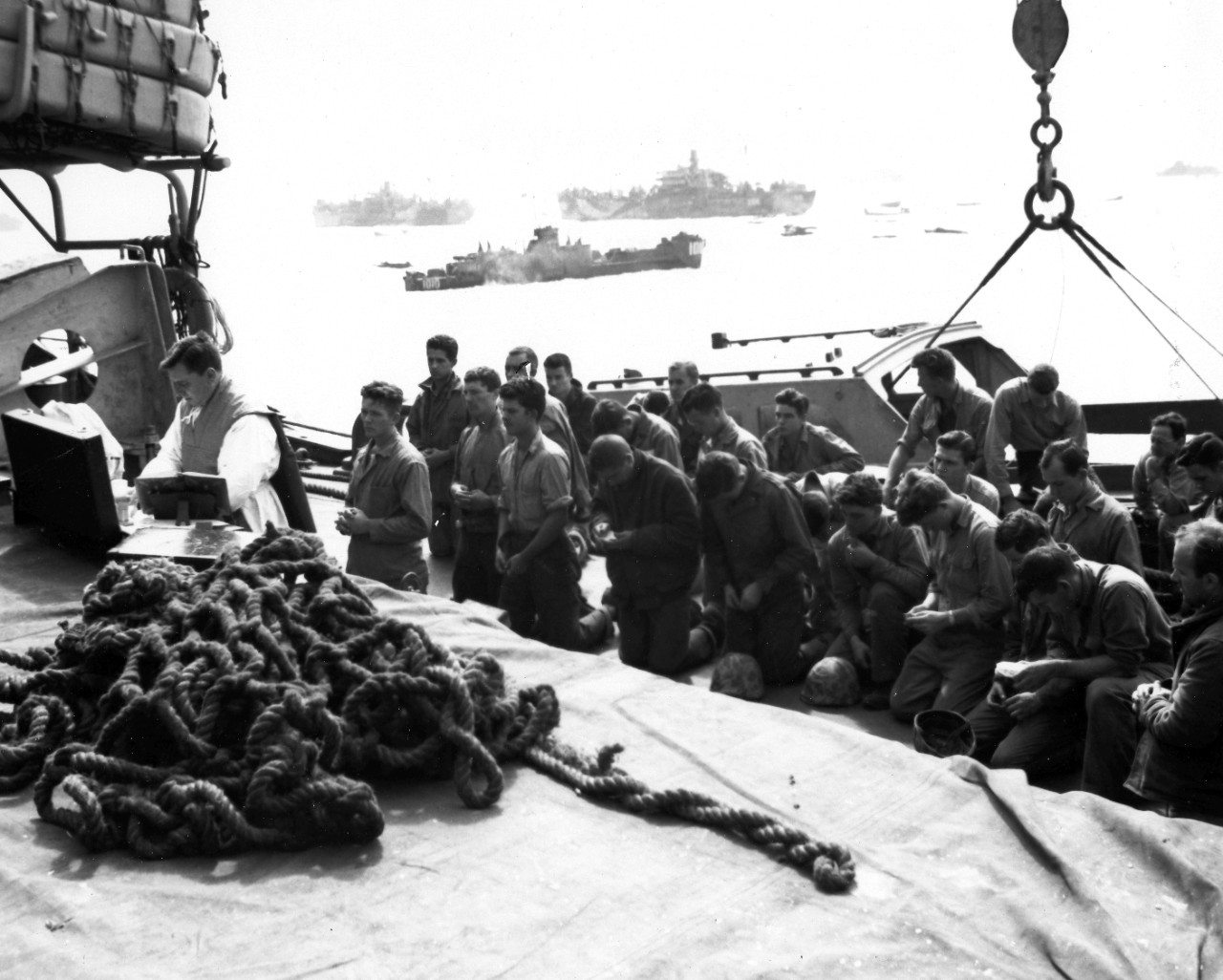 <p>Men of the floating reserve regiment (4th Marine Division) attend a Catholic mass before their time in hell.</p>