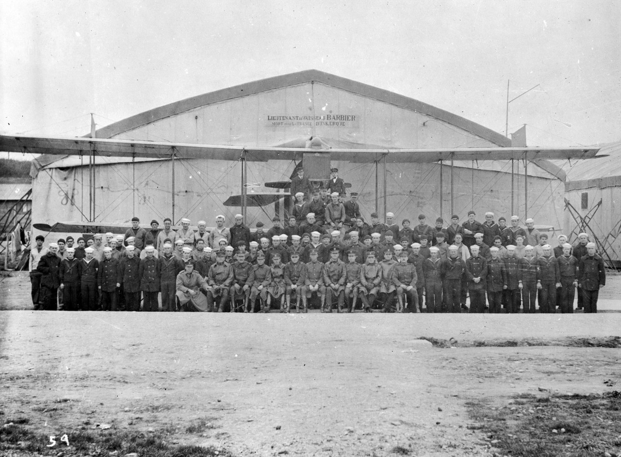 Personnel, aircraft, and hangar at Treguier Air Station- WWI. Part of the US Naval Aviation French Unit Collection.