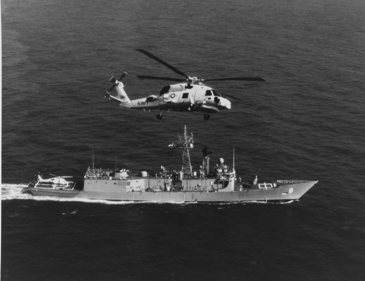 "SIKORSKI SH-60B ""SEAHAWK"" Helicopter in flight over USS MCINERNY (FFG-8), in March 1981"
