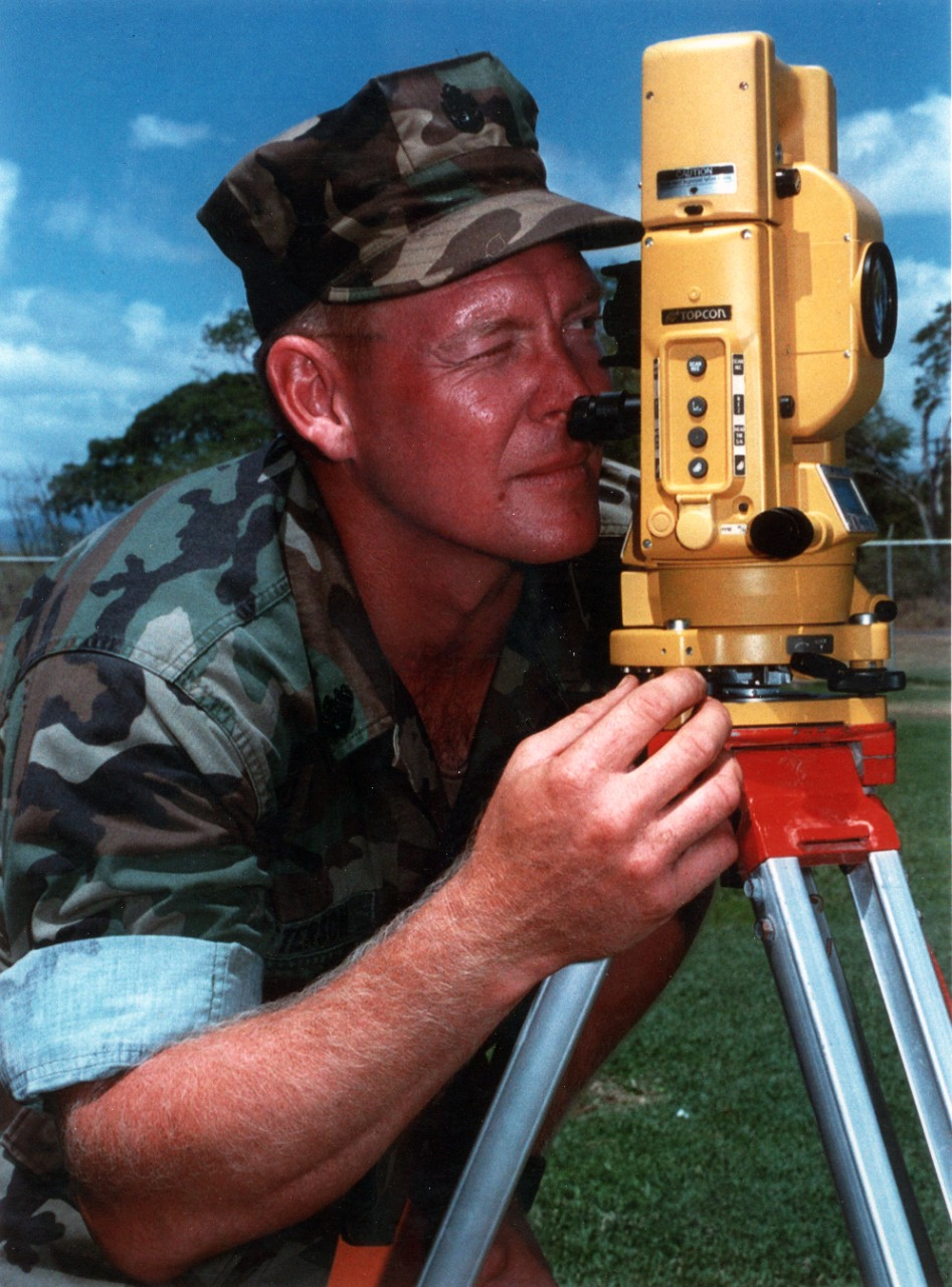 Navy Builder Chief Paul Patterson surveys underground cable locations on board Naval Air Station Barbers Point, Hawaii.