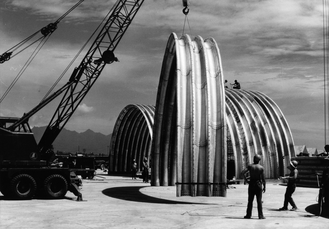 Seabees of U.S. Naval Mobile Construction Battalion Eight move a section of an aircraft shelter into place at the Marine Air Group Eleven Area, Da Nang, Republic of Vietnam.