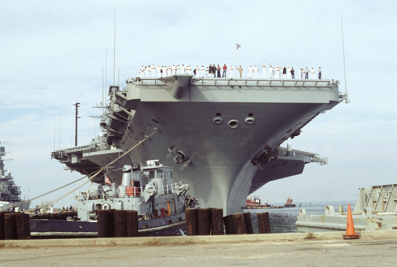 Dwight D. Eisenhower (CVN–69), the first combatant ship with a mixed-sex crew, leaving Norfolk, Virginia, for a six-month deployment, 20 October 1994. (National Archives, 6493349)