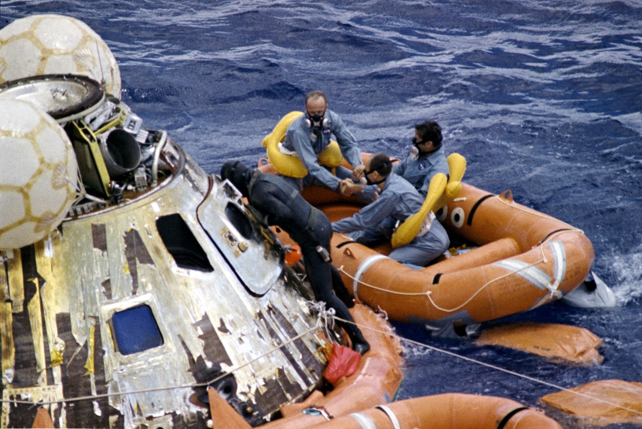 Navy Underwater Demolition Team swimmer assists the Apollo 12 crew during recovery operations