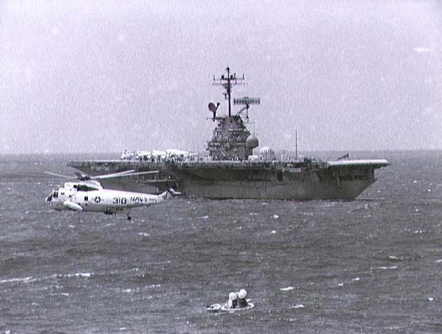 USS Hornet moves toward the Apollo 12 Command Module to retrieve it