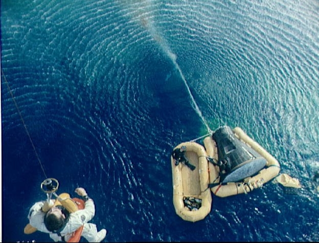 Navy frogman assist Gemini 10 astronauts following splashdown