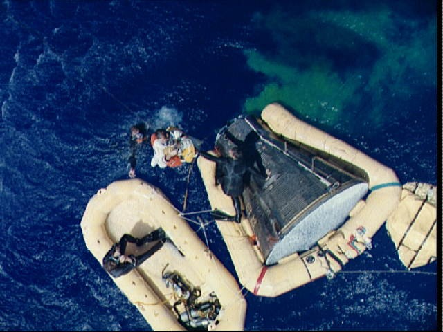Astronaut Richard Gordon hoisted aboard recovery helicopter