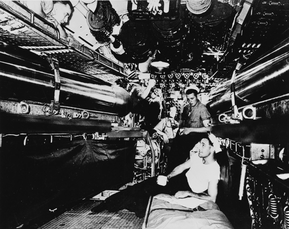 Submariners in the torpedo room
