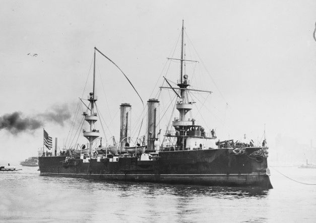 New Orleans (1898-1929) arrives off the New York Navy Yard, April 1898, after crossing the Atlantic. Note oversize commissioning pennant flying from her main mast.