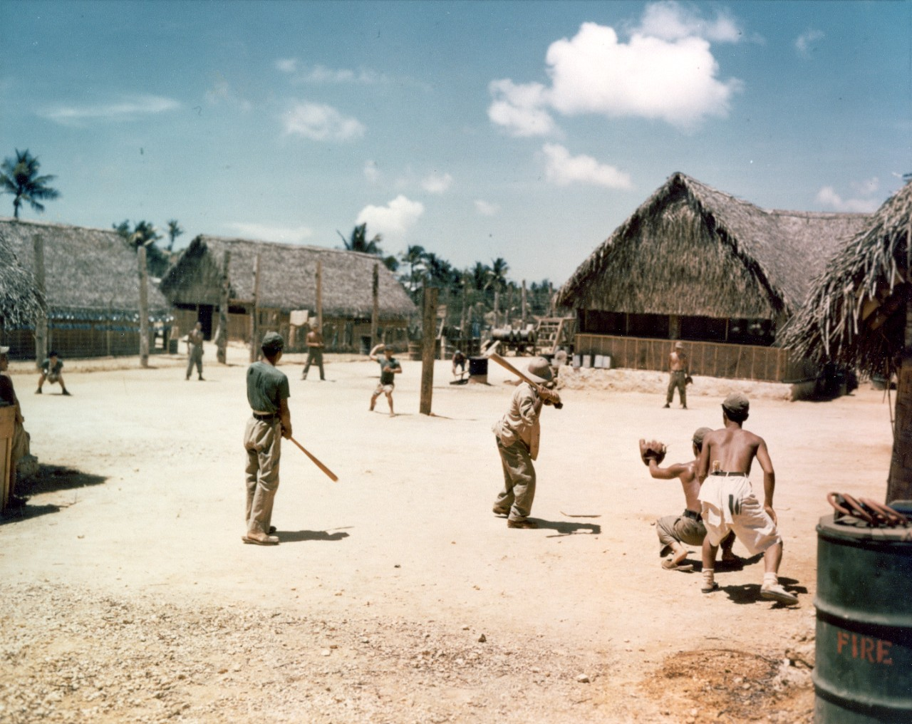Japanese POWs playing baseball at a Guam POW stockade, 1945.