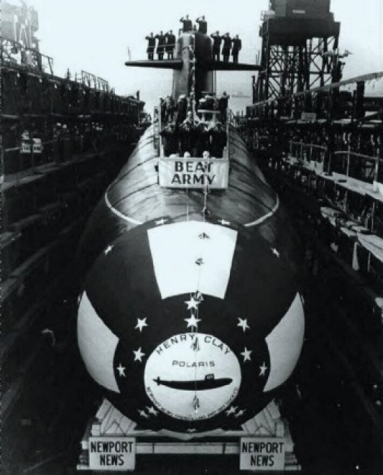 "Henry Clay (SSBN-625) before launched at Newport News, Va., 30 November 1962, with ""Beat Army"" banner displayed."