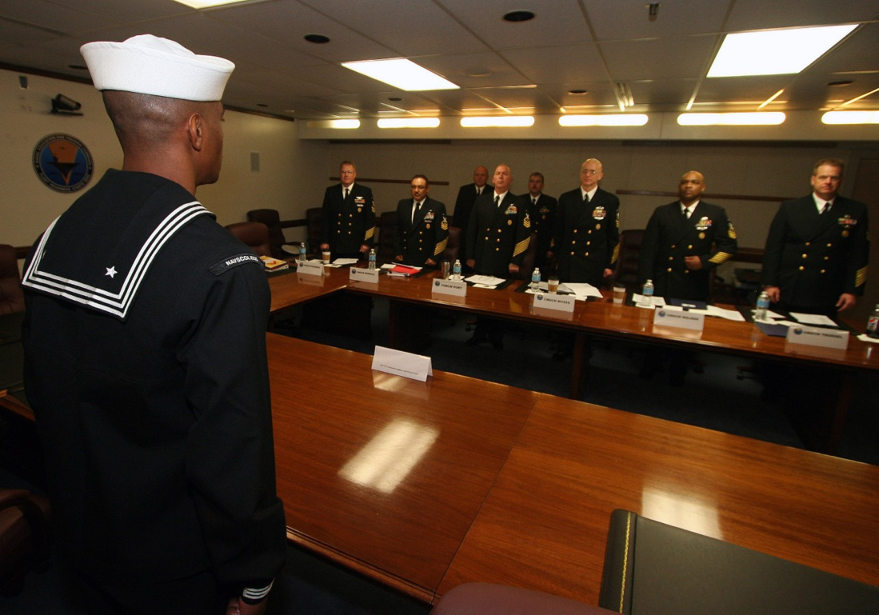 Command master chiefs from Naval Education and Training Command's (NETC) domain listen to Engineman 1st Class Sivenson Guerrier recite The Sailor's Creed during his Sailor of the Year board.