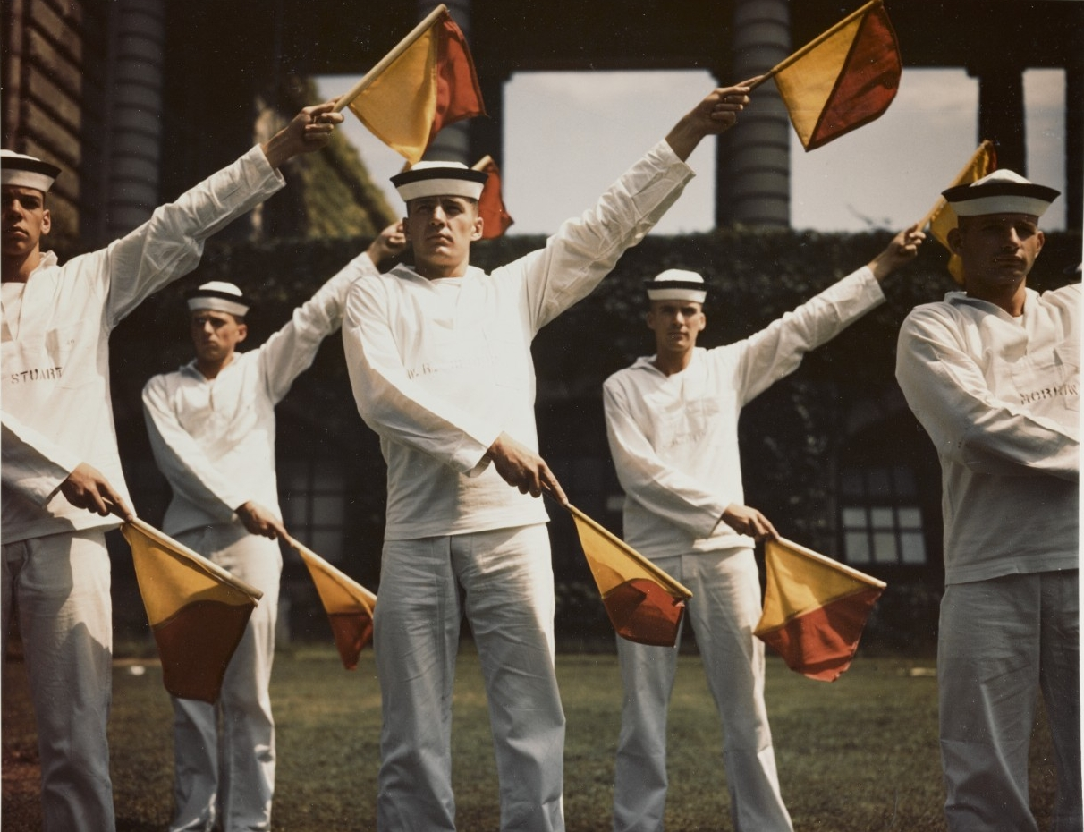 U.S. Naval Academy, Annapolis, Maryland. Midshipmen practice signaling with Semaphore flags, circa 1945