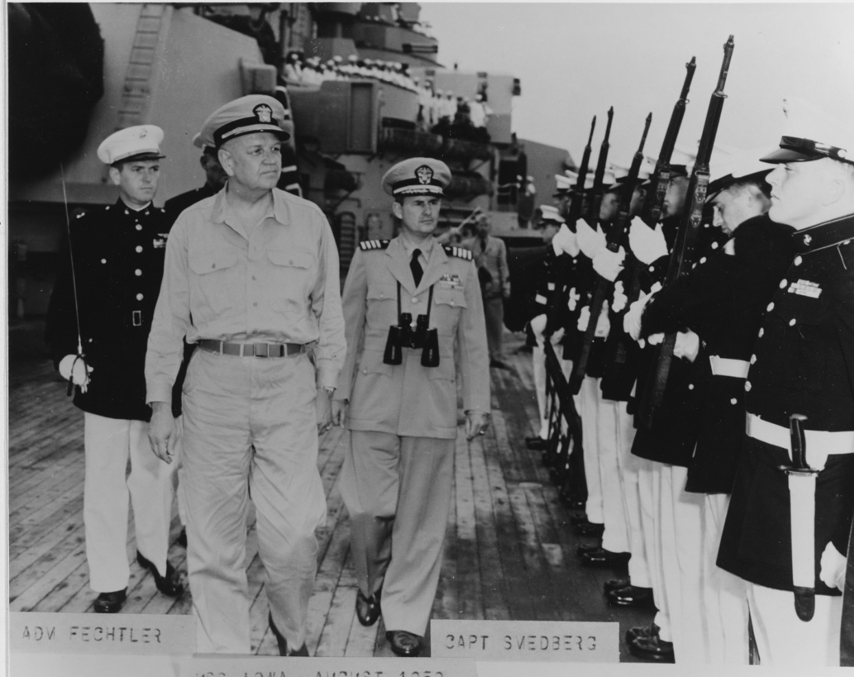 Admiral Fechteler is escorted by Captain William R. Smedberg III, while inspecting Marines aboard the USS Iowa in August 1952, off Wonsan, Korea.