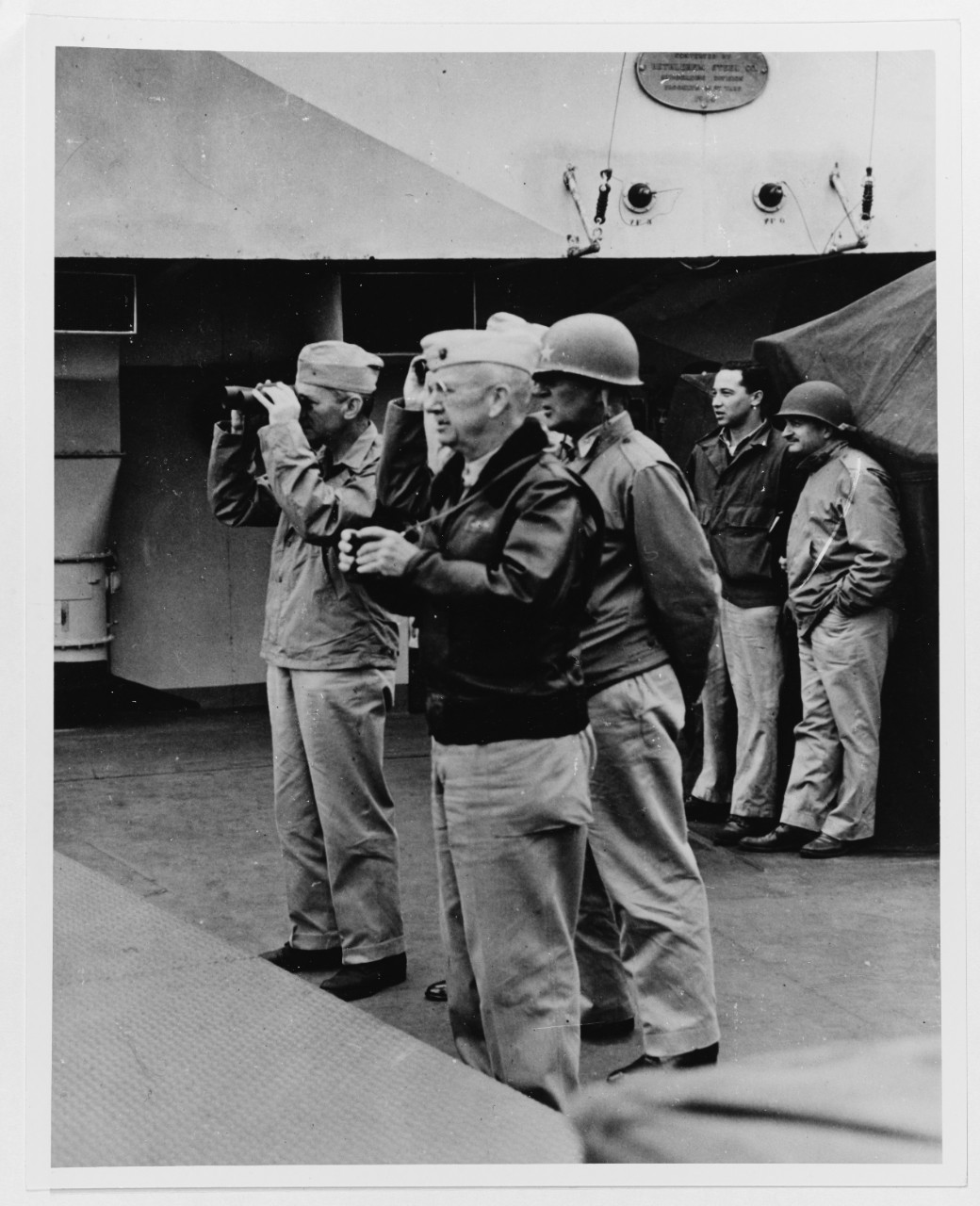 Secretary of the Navy James Forrestal and operation leaders watch invasion activities from on board USS Eldorado (AGC-11), 20 February 1945.