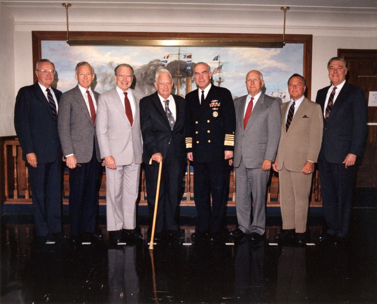 The current CNO, Admiral Frank Kelso, with former CNOs at the Pentagon, 19 October 1990. Those present are (from left to right): Admiral Carlisle A.H. Trost, CNO in 1986-1990; Admiral Thomas Hayward, CNO in 1978-1982;   Admiral Elmo Zumwalt, CNO in 1970-1974; Admiral Arleigh A. Burke, CNO in 1955-1961; Admiral Kelso; Admiral Thomas Moorer, CNO in 1967-1970; Admiral James Holloway, CNO in 1974-1978; and Admiral James Watkins, CNO in 1982-1986.  Photographed by Dave Wilson. Official U.S. Navy Photograph, from the collections of the Naval History and Heritage Command.
