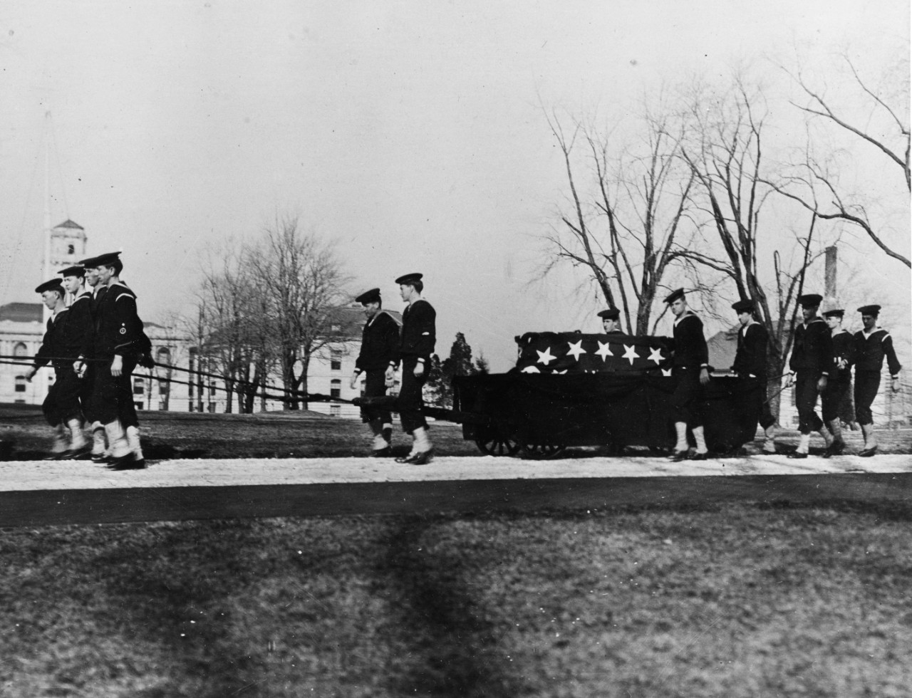 A 26 January 1913 photo by Mrs. C. R. Miller, showing the guard of honor transporting the remains of John Paul Jones to the crypt of the Chapel of the Naval Academy on the Naval Academy grounds.