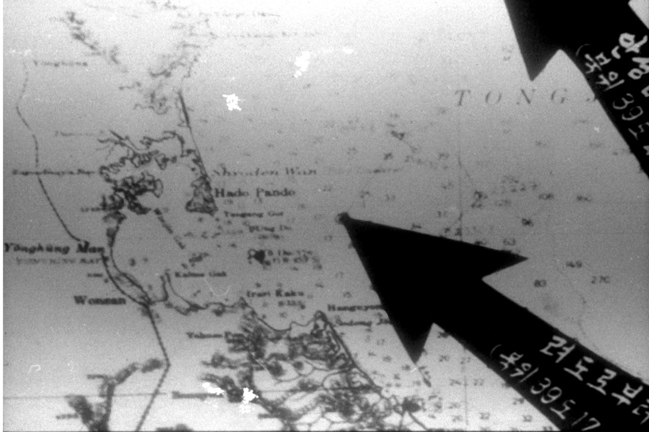 Poor quality photograph of a chart of the Wonsan area, North Korea, that was exhibited by the North Korean government to support their claim that USS Pueblo had entered that state's territorial waters. Click image to download.