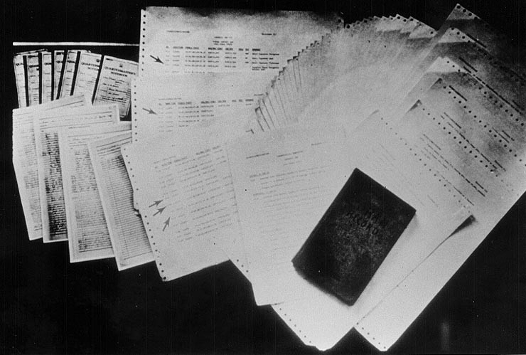 Poor quality photograph of navigation documents attributed to USS Pueblo. Click image to download.