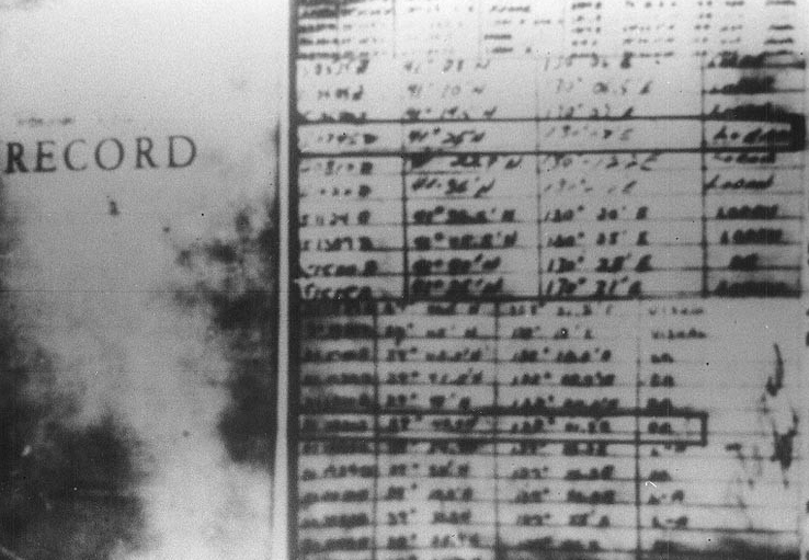 Poor quality photograph of apparent position entries from the log of Pueblo issued by the North Korean government to support their claim that Pueblo had entered that state's territorial waters. Click image to download.