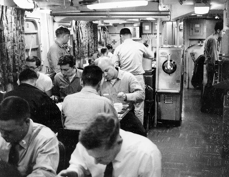 Scene in the crew's messing spaces, during a meal, 1967.