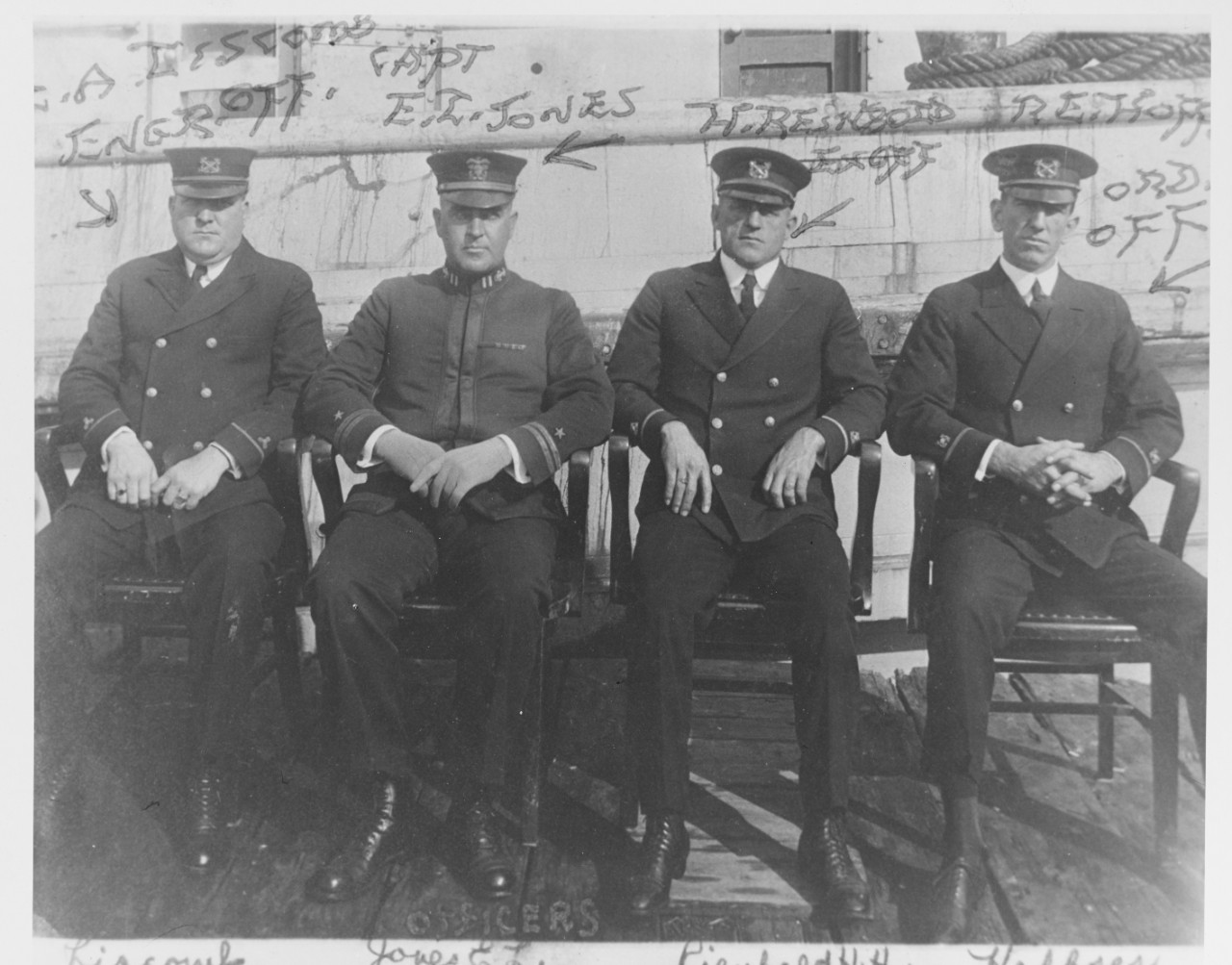 black and white photo of 4 men in naval officer uniforms identified with handwriting