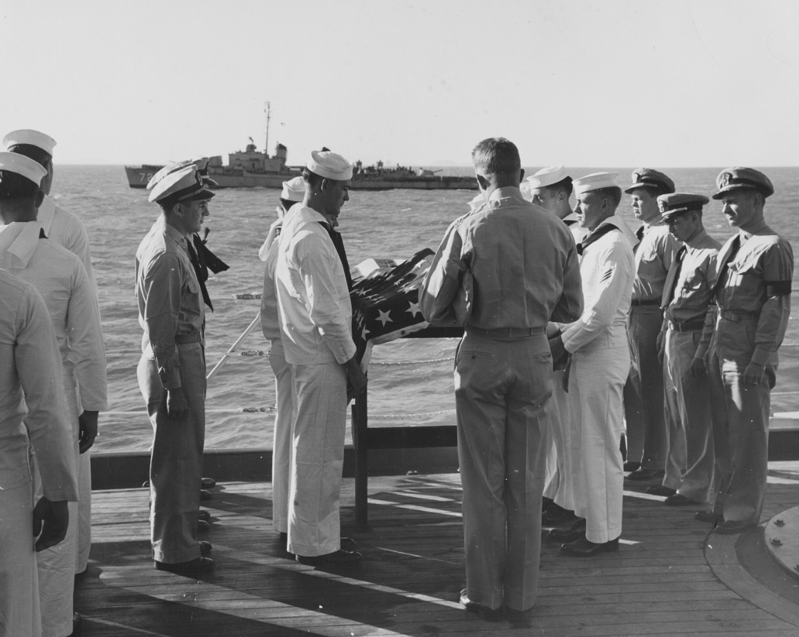 A Chaplain reads the Last Rites service as Lieutenant (Junior Grade) David H. Swenson is buried at sea from USS Toledo (CA-133), off Inchon, Korea.