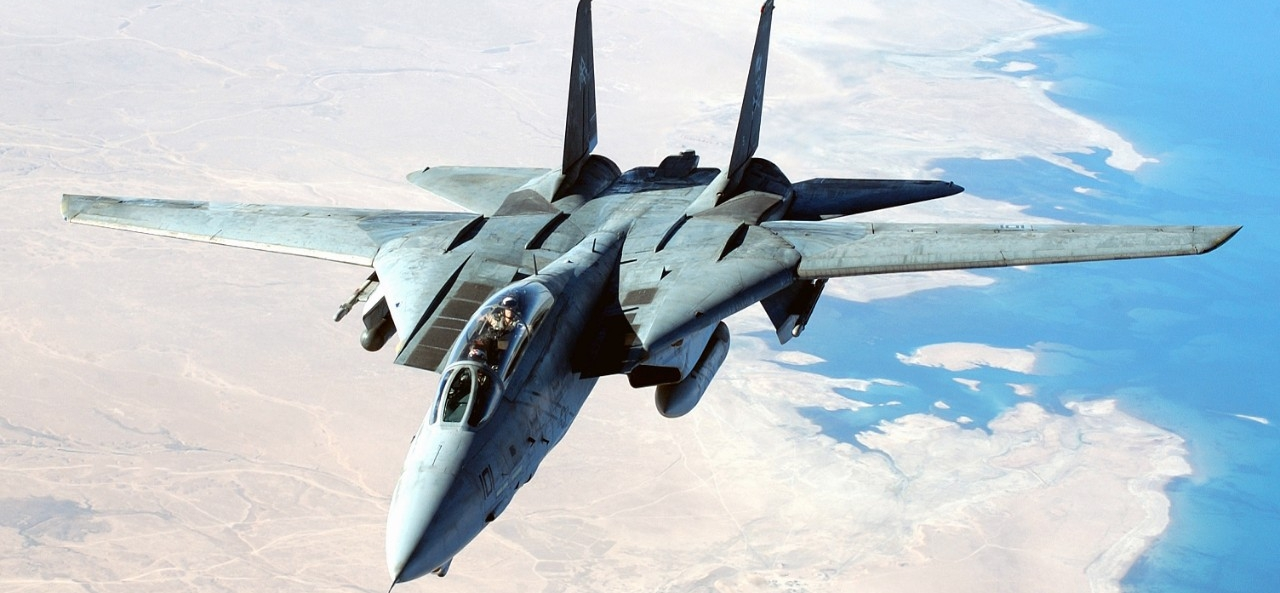 A U.S. Navy F-14D Tomcat aircraft flies a combat mission in support of Operation Iraqi Freedom, 14 August 2004. National Archives Identifier: 6660203.