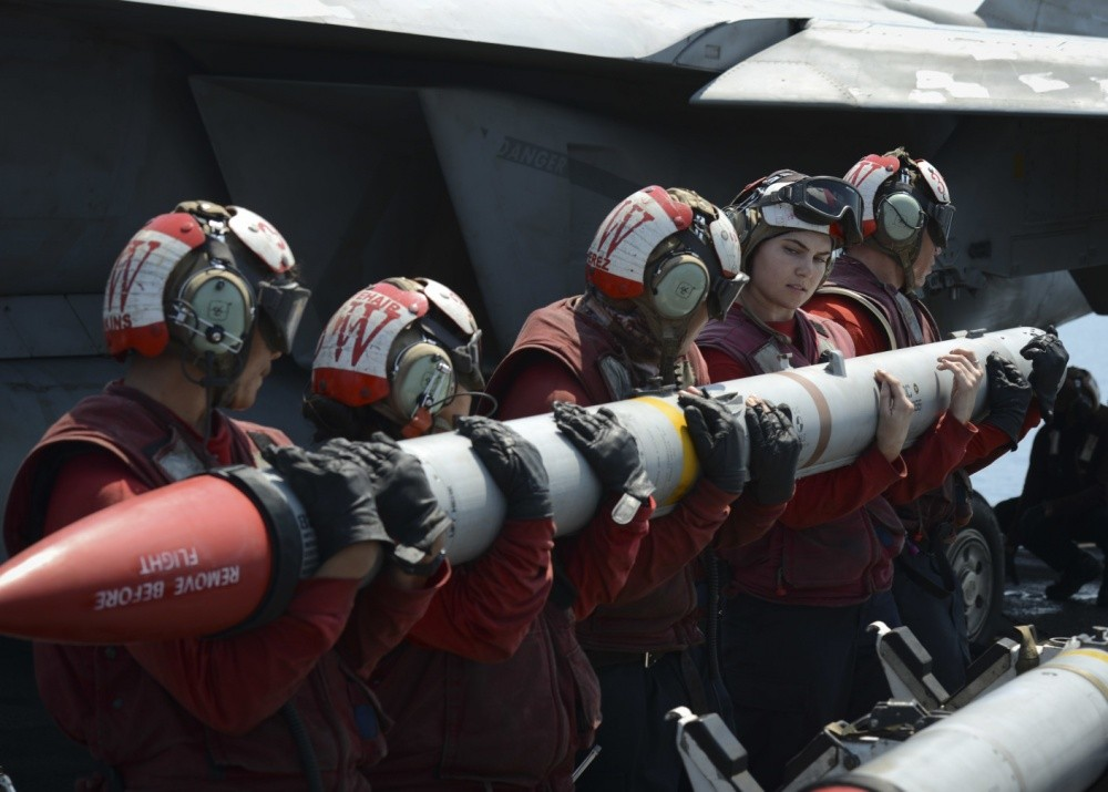 Sailors load an AIM-120C missile