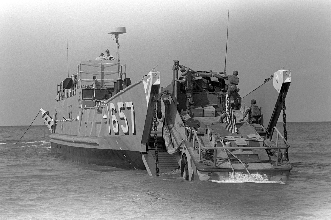 U.S. Marines drove a lighter amphibious resupply cargo vehicle (LARC-V)