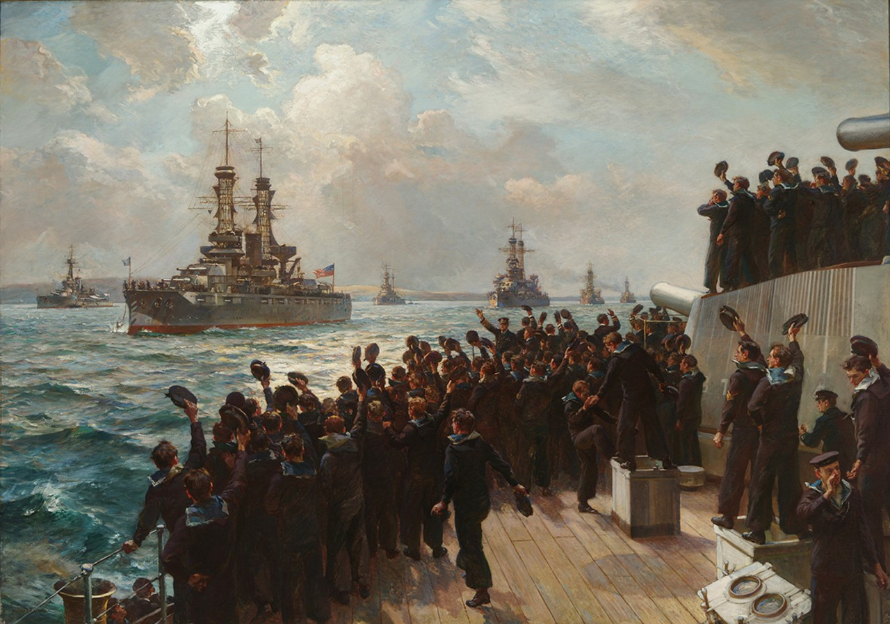Sailors on the deck of a ship wave their hats at a fleet of ships
