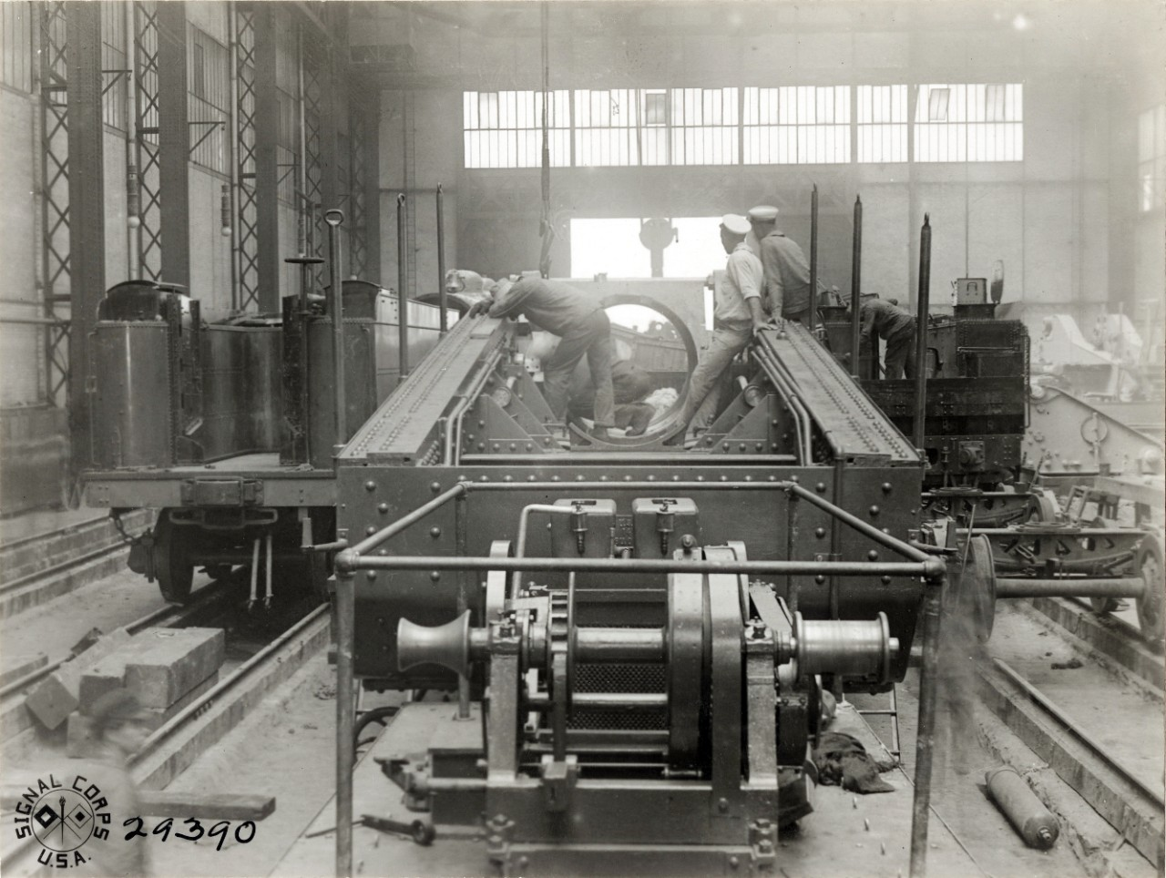 111-SC-29390: 14-Inch Railway Gun.  Men greasing the slide to receive the rifle at U.S. Naval Railway Battery, St. Nazaire, France.   Photographed by Corporal L.H. McLaughlin, SC, August 1, 1918.    U.S. Army Signal Corps Photograph, now in the collections of the National Archives.    Archival photograph taken by Mr. James Poynor.