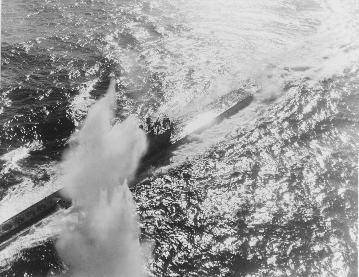 Fighting the foe from Salerno to Tarawa--Depth charge blasts Nazi sub