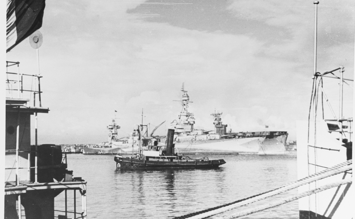 USS AUGUSTA (CA-31) in Casablanca Harbor, Morocco, November 12, 1942. A French tug is in the foreground