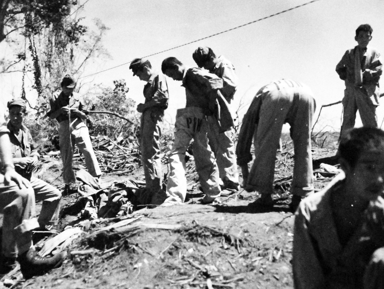 127-GW-971-89059:  Battle of Cape Gloucester, New Britain, December 1943-January 1944.  Japanese prisoners putting on clean closes.  Photographed by Howard, March 1944.  Official U.S. Marine Corps Photograph, now in the collections of the National Archives.   (2014/7/9).