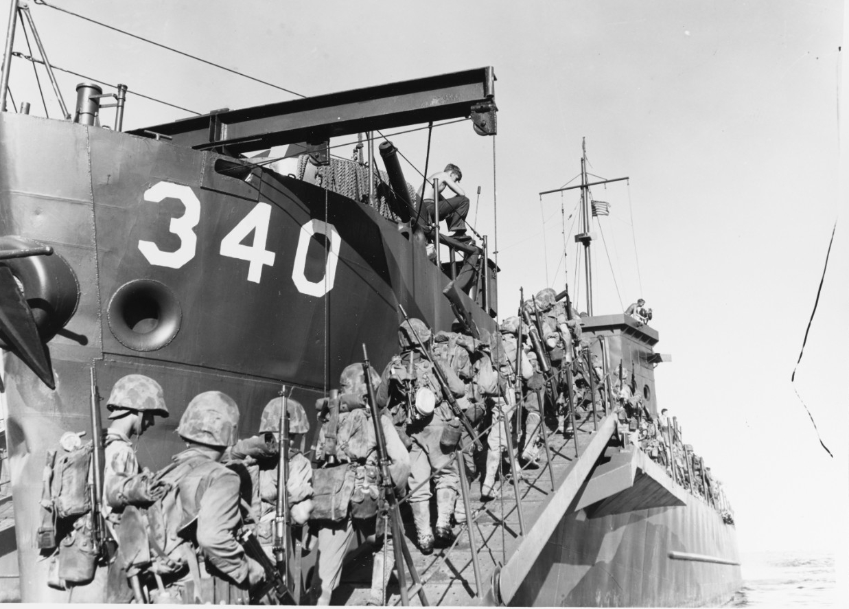 Marines boarding USS LCI-340 on the day before Christmas, 1943